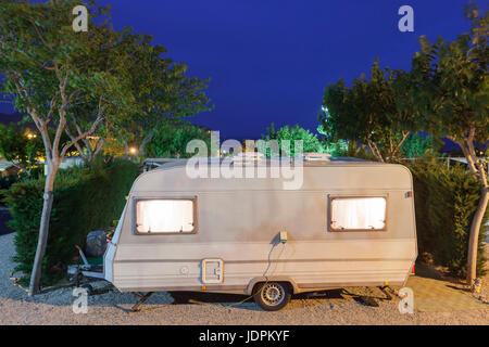 Mobile Home Or Caravan On A Camping Site Illuminated At Night