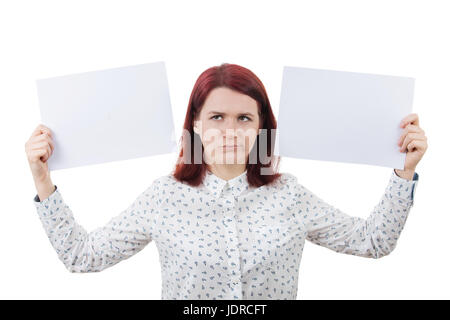 Confused young woman holding two white papers in hands, isolated on white background. Human emotion, face expression - Stock Photo