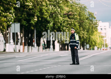 Gomel, Belarus - May 9, 2017: Traffic Road Police Officer Policeman Inspector Regulates Traffic At The Crossroads - Stock Photo