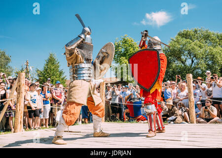 Dudutki, Belarus - July19, 2014: Historical restoration of knightly fights on festival of medieval culture. Knights - Stock Photo