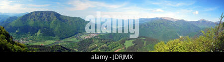 spectacular panorama with Vah river valley with few villages, Velka Fatra and Mala Fatra mountain range and blue - Stock Photo