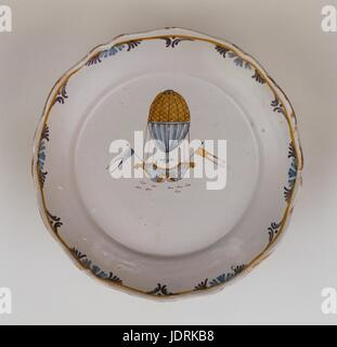 Faience plate with polychrome decoration and curved edging, Nevers  Charles and Robert's first ascent on 1st December - Stock Photo
