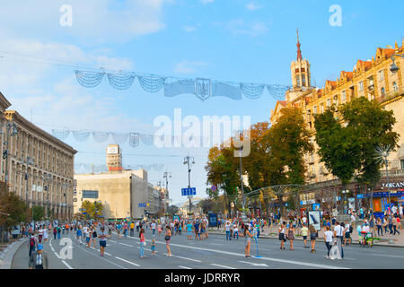 KIEV, UKRAINE - AUG 17, 2016: People walking on the Khreschatyc street. Khreshchatyk is the main street of Kiev - Stock Photo