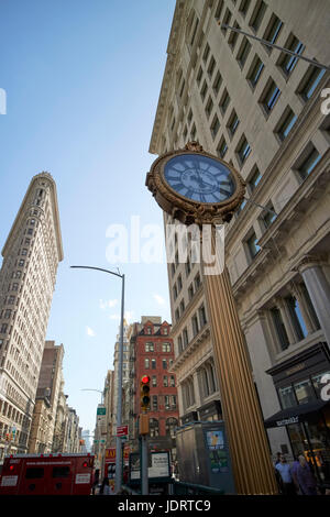landmark fifth avenue building clock outside the toy center and gridiron building New York City USA - Stock Photo