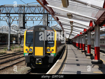 London Midland liveried class 350 Desiro electric multiple unit waits, in platform 2 at Crewe railway station, for - Stock Photo