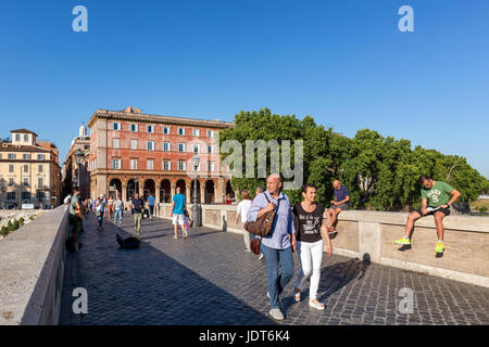 People walking on Ponte Sisto to go in Piazza Trilussa, Trastevere, Rome, Italy - Stock Photo