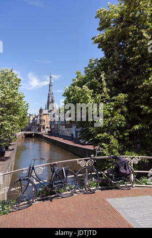 bicycles parked on bridge in centre of old town leeuwarden in friesland with boniface church in the background on - Stock Photo