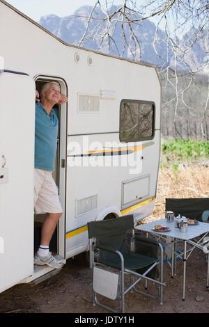 Older man at door of RV - Stock Photo