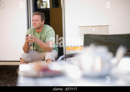Man camping with RV - Stock Photo