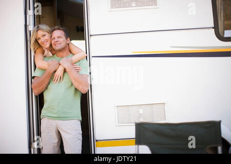 Couple camping with RV - Stock Photo