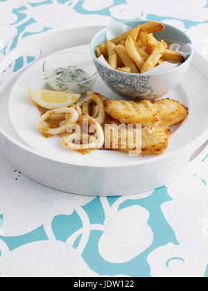 Bowl of chips with fish and lemon - Stock Photo