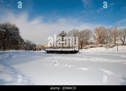 Fountain above Central Park lake in winter, Manhattan, New York City, USA - Stock Photo