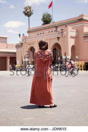Woman standing off Jamaa el Fna Square, Marrakech, Morocco - Stock Photo