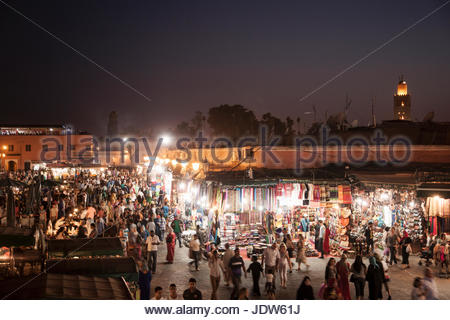 Crowded market stalls at night, Jamaa el Fna Square, Marrakech, Morocco - Stock Photo
