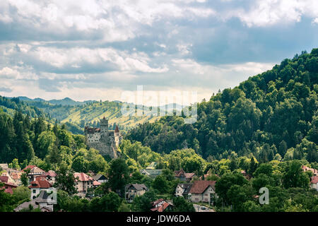 Countryside overlook view of houses and castle over the hills in the summer - Stock Photo