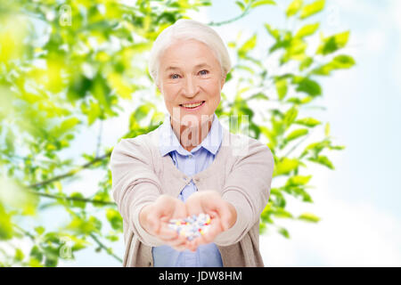 happy senior woman with medicine at home - Stock Photo