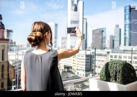 Businesswoman in Frankfurt - Stock Photo