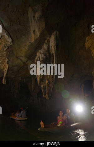 Phuket, Thailand, January 30, 2017: Tourists swim in the boat inside the cave on an excursion. - Stock Photo