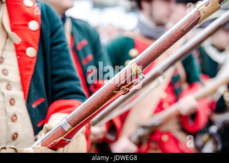 Building musketeers with guns. Focus on gun - Stock Photo