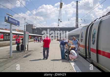 Passengers on platform after alighting from train, Munich main railway station, Germany - Stock Photo