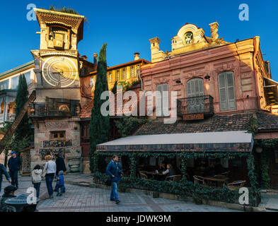 Tbilisi, Georgia - October 15, 2016: Clock Tower of puppet marionette theater Rezo Gabriadze in evening. The old - Stock Photo