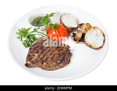 Beef steak with chimichurri sauce and vegetables. Isolated on a white background. - Stock Photo