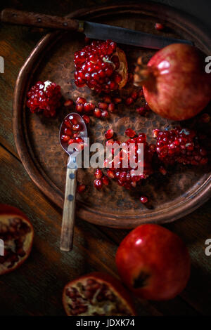 Healthy food concept, juicy pomegranates on vintage background - Stock Photo