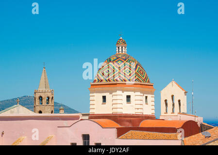 Alghero Sardinia skyline, view of the majolica tiled dome of the San Michele church in the centre of the old town - Stock Photo