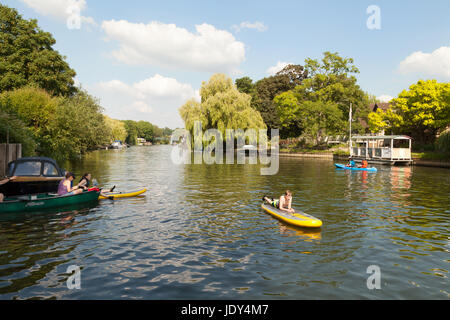 Teens swimming and boating on the River Thames near Henley on Thames, Oxfordshire England UK - Stock Photo