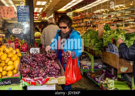 Chinese-American woman, Chinese-American, woman, shopper, shopping, fruit and vegetable market, Stockton Street, - Stock Photo