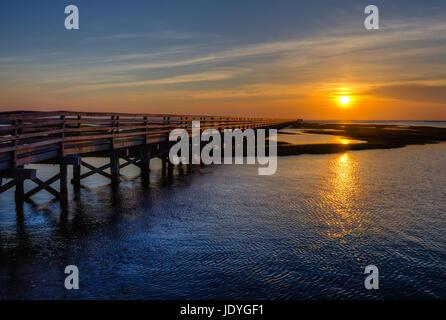 Sunset over the Chase Garden Salt Marsh on Cape Cod - Stock Photo
