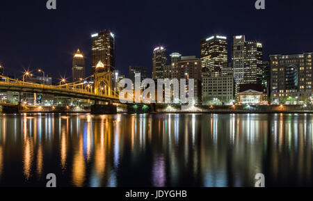 Pittsburgh, Pennsylvania skyline at night overlooking the Allegheny River with the Andy Warhol Bridge. - Stock Photo
