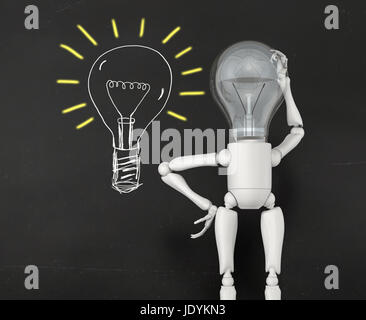 a lamp character without any ideas with the bulb light switched off looks at a lamp bulb with yellow lighting marks - Stock Photo