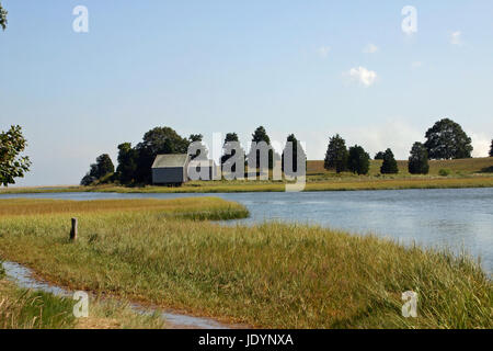 A weathered, gray-shingled shack on Salt Pond at the Cape Cod National Seashore, Eastham, Massachusetts, viewed - Stock Photo