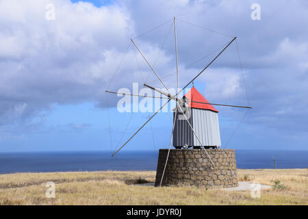 Traditional windmills that once produced flour for ships on the way to America found on the hillside in Porto Santo - Stock Photo
