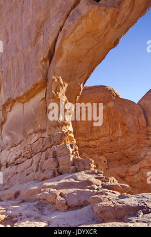 Iconic Windows sandstone arch formation in Arches National Park in close up, vertical photograph showing blue sky. - Stock Photo