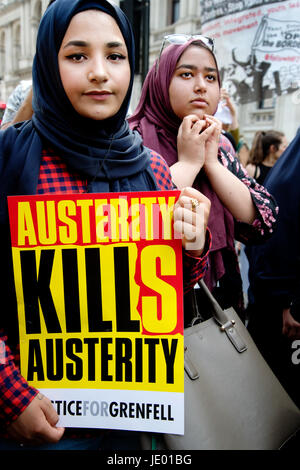 London, UK. 21st June, 2017. Day of rage protest after the fire at Grenfell House, West London. A woman holds a - Stock Photo