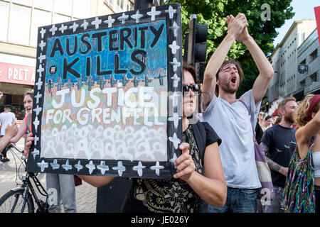 Bristol, UK, 21st June, 2017. Protesters carrying placards are pictured as they take part in a Austerity kills, - Stock Photo