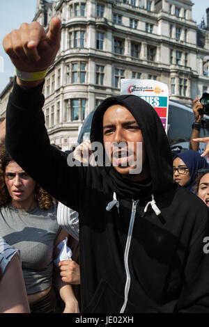London, UK. 21st June, 2017. Protesters block Westminster Bridge Road at the end of a 'Day of Rage' march by activists - Stock Photo