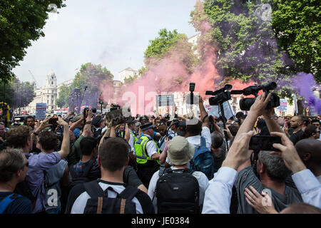 London, UK. 21st June, 2017. Smoke grenades outside Downing Street during a 'Day of Rage' march by activists from - Stock Photo
