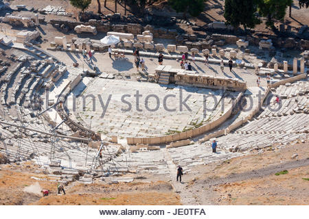 ATHENS, GREECE - OCTOBER 6 : Tourists sightseeing the reconstruction of the Theatre of Dionysus in the Acropolis - Stock Photo