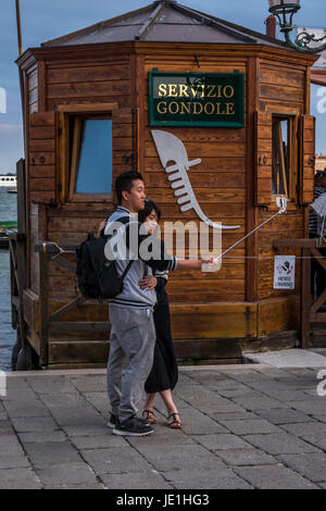 Tourists in Venice taking selfie - Stock Photo