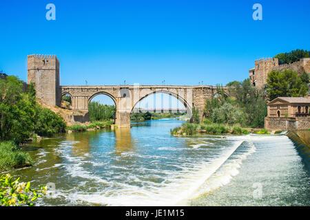 Saint Martin medieval bridge over tajo's river in Toledo, Castilla la Mancha, Spain - Stock Photo
