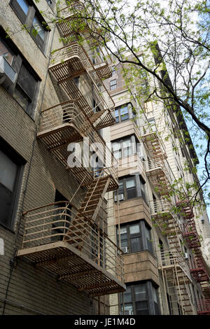 metal rusting fire escapes on apartment buildings chelsea New York City USA - Stock Photo