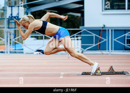 Explosive Start Female Athlete Sprinter Run 200 Meters During UrFO Championship In Athletics