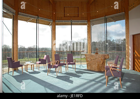 Interior of a newly-built timber chapel at a hospice in rural England - Stock Photo