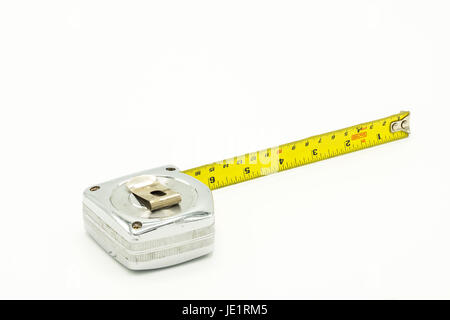 Used and old measuring tape, usually used in construction business or general purpose of measurement - Stock Photo