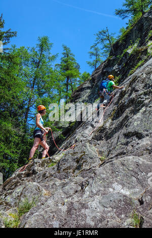 Two rock climbers on cliff face, Chamonix, France - Stock Photo