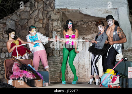 Bizarre comedia del arte performers tied up with rope - Stock Photo