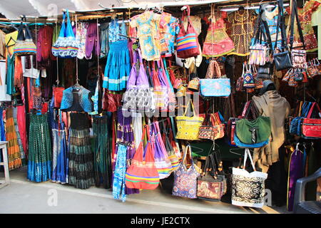 Window display of apparels and bags in a street - Stock Photo